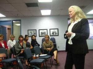 Sharon Lechter congratulates first Phoenix YMCA Money Smart graduates